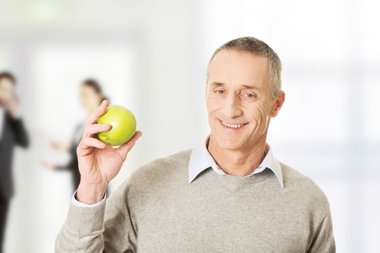 Mature man with an apple.
