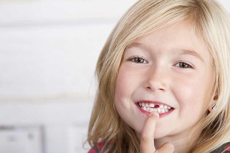 child missing tooth