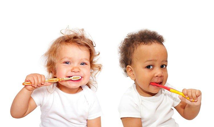 babies brushing teeth