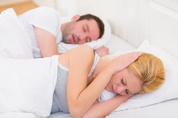 woman can't sleep because of husband's snoring