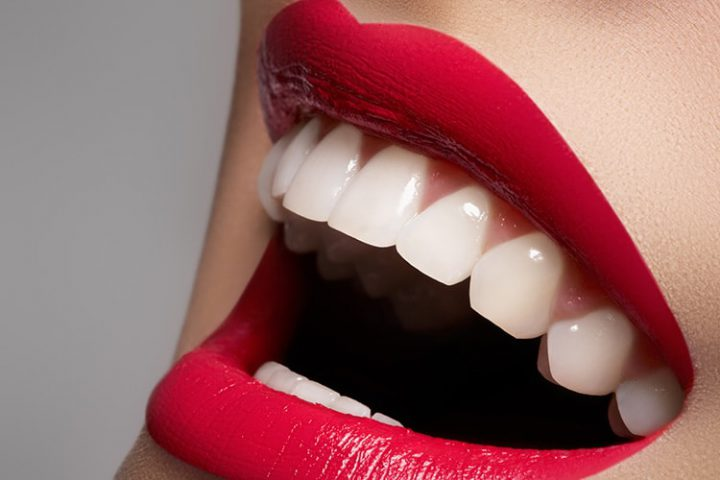 Beautiful white teeth and red lips