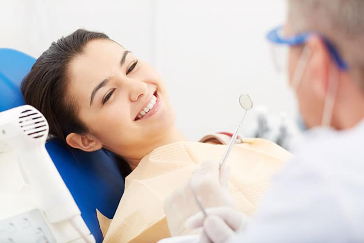 Beautiful girl in dentist chair
