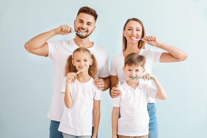 Family brushing teeth